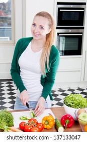 young woman cooking vegetarian food in kitchen