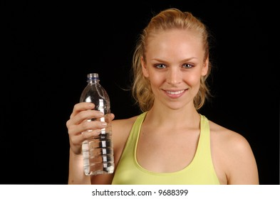 Young woman cooling down after exercise session.