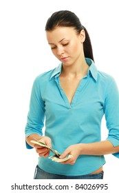 Young woman counting money isolated on white background