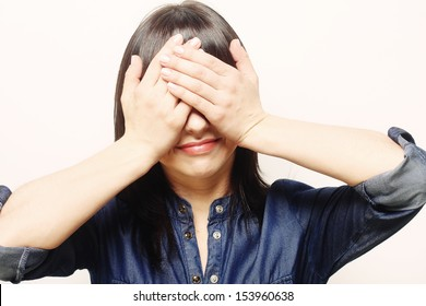 Young woman covering her eyes