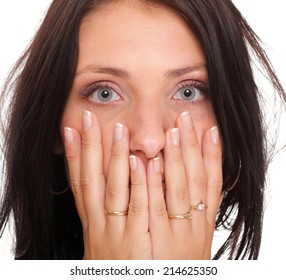 Young woman covering her mouth with both hands isolated over white background