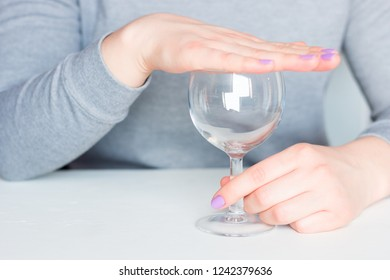young woman covers her glass refusal alcohol