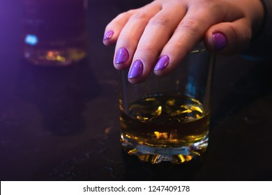 young woman covers her glass with her hand. alcohol rejection