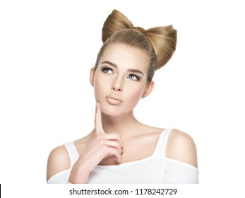 Young woman with a creative hairstyle got an idea thinking. Girl wondering with her finger pointed up isolated on white background.
