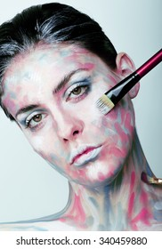 young woman with creative make up like painted oil picture on face closeup