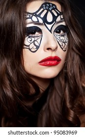 Young woman with creative makeup