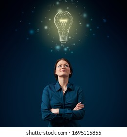 Young woman creative professional and symbol of idea (light bulb), creative thinking, innovations and intelligence. Artificial intelligence (AI) concept.