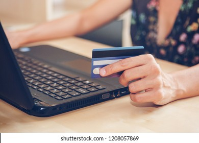 Young woman with a credit card is shopping online in the office. Blackfriday and cybermonday concept.