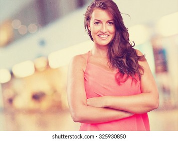 young woman crossing arms