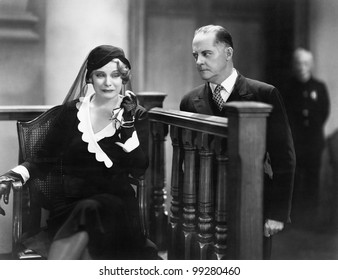 Young woman crying in a courtroom