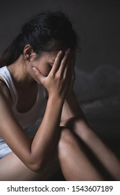 A young woman crying and covering her face. depression or domestic violence. The concept of sexual harassment against women and rape.  human trafficking,  international women's day.