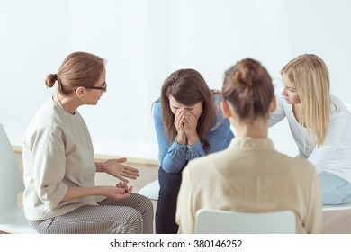Young woman is crying during support group meeting