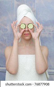 young woman with a cucumbers on eyes