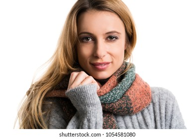 young woman cuddling in her pullover isolated on white