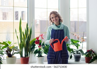Young woman cultivating home plants