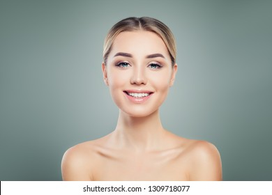 Young woman with cute smile. Beautiful smiling model portrait
