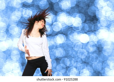 Young woman dancer. With bokeh lights effect.