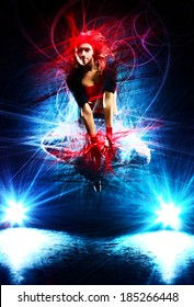 Young woman dancer jumping. With special light effects.