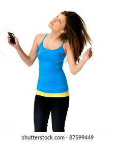 young woman dances while listening to music on her mp3 player