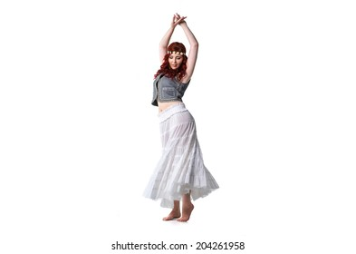 Young woman dancing barefoot isolated on white background