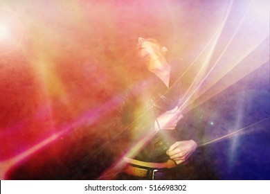 young woman dancing in a club and feel the music and free