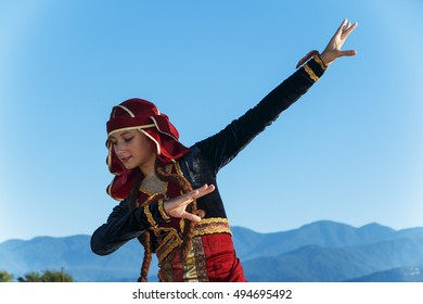 young woman dancing georgian national clothes mountains outdoors summer sunny