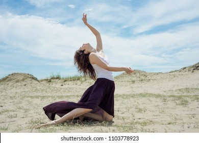 Young woman dancing in nature
