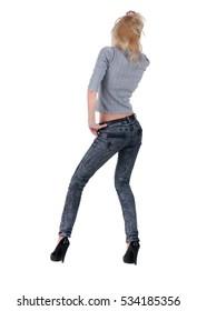 Young woman dancing. Rear view.