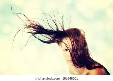 Young woman dancing with wind