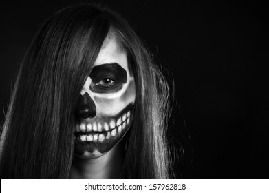 Young woman in day of the dead mask skull face art. Halloween