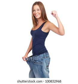 Young woman delighted with her dieting results, isolated on white