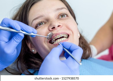 Young woman at the dentist braces check up