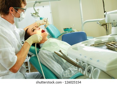 Young woman with dentist in a dental surgery. Healthcare, medicine.