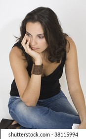 Young woman depressed on white background