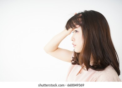 Young woman developing a fever because of a cold