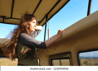 Young woman discover african nature by car Tanzania safari