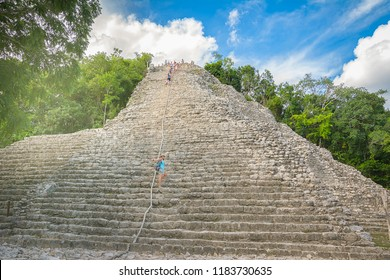 Young woman discovering the amazing Nohoch Mul Pyramid in Coba, Mexico