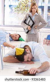 Young woman discovers sleeping colleagues in office after last night party.?
