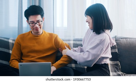 Young woman distracting her boyfriend from working. Remote work disadvantages. High quality photo