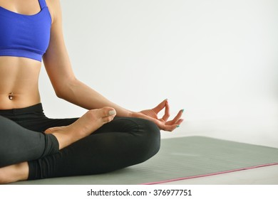 Young woman do yoga indoors
