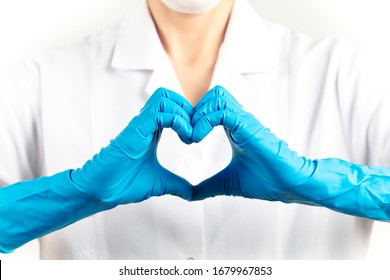 young woman doctor doing the heart sign. White background