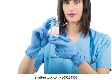 young woman doctor with pills in hand