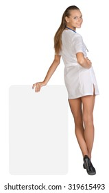 Young woman doctor standing backward, leaning hand on an empty billboard.