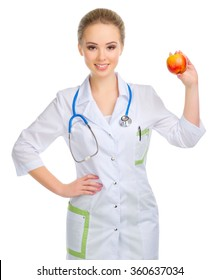 Young woman doctor with stethoscope and apple isolated