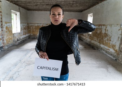 Young woman doesn't like capitalism at all, bad times in front of us