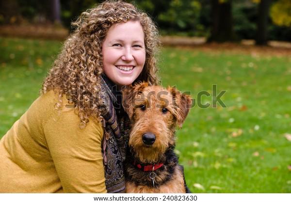 Young woman with dog in a park