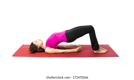 Young woman doing Bridge Pose in Yoga and Pilates (Series with the same model available)