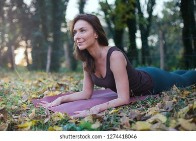 young woman doing exercise in nature