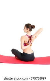 Young woman doing exercises on a mat. isolated on white background