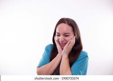 Young woman doing facial expressions in a studio
